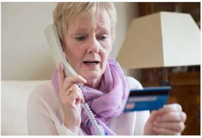 Woman providing credit card details over the phone